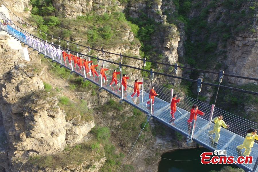 Taichi performance on glass skywalk